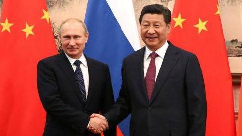 习近平和普京互致新年贺电,愿继续巩固中俄政治和战略互信