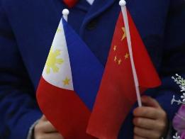 中菲联合声明:南海争议不是中菲关系全部 不诉诸武力