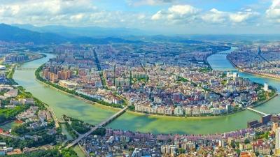 壮丽七十年丨城市巨变:长卷铺开绘新图  世界客都绽芳华